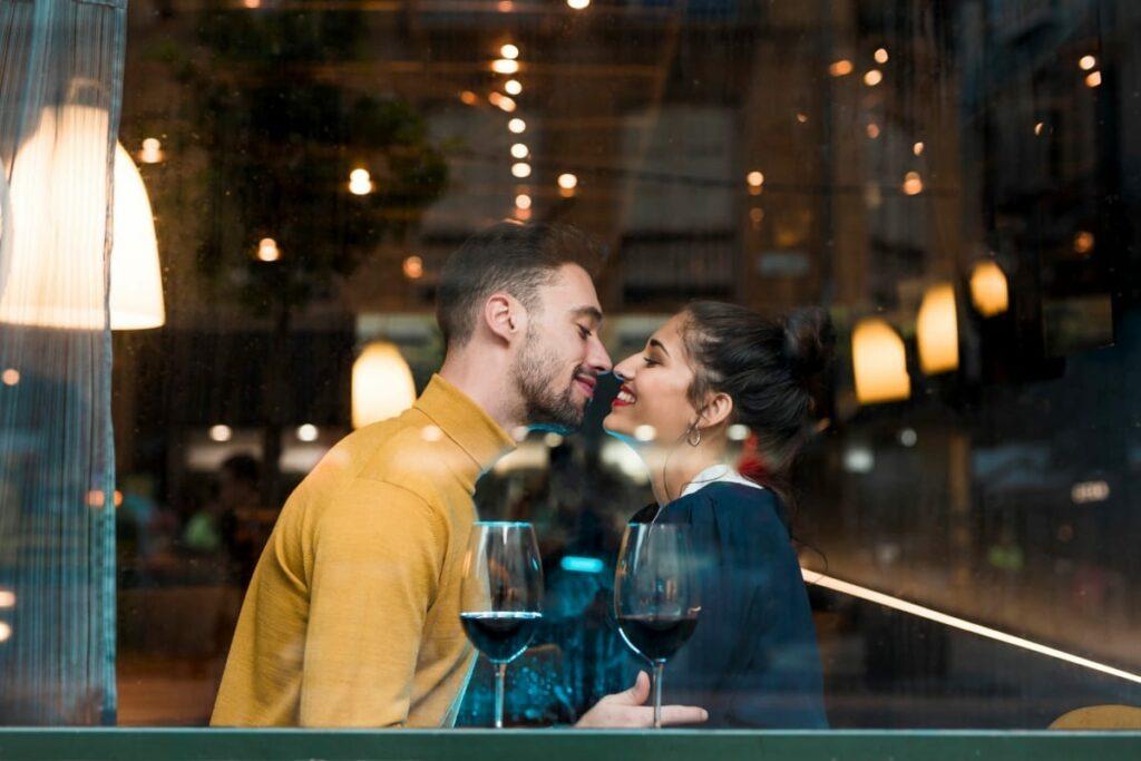 happy man woman near glasses wine restaurant