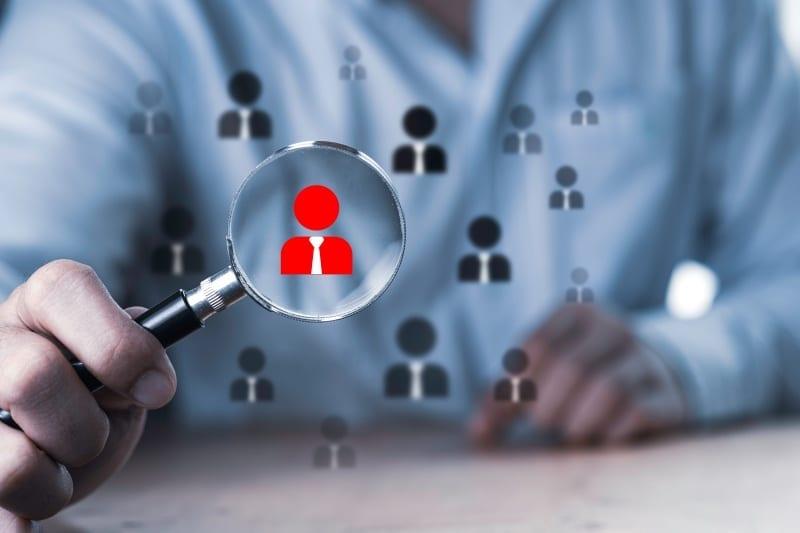 human development recruitment concept business man using magnifier glass searching proper employee